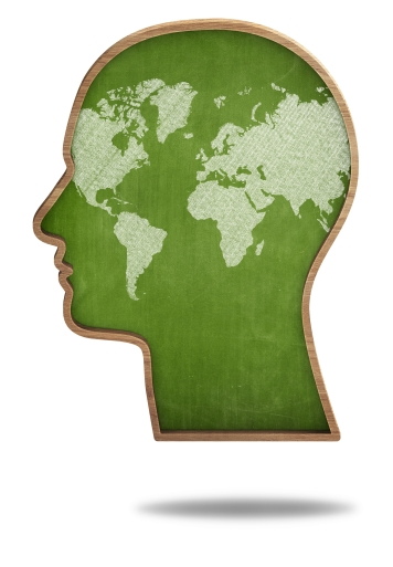 World map concept on head shape green blackboard