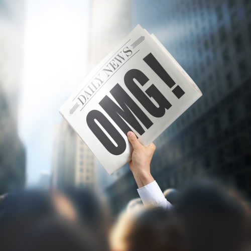 Holding Newspaper with OMG