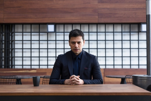 Portrait of confident businessman looking at camera
