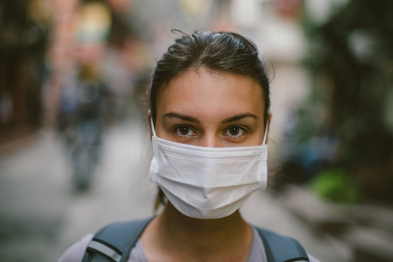 Young woman with face mask in the street